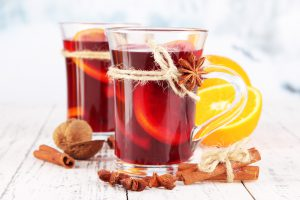 Mulled wine with oranges and spices on table on bright backgroundMulled wine with oranges and spices on wooden backgroundMulled wine with lemon and spices isolated on white