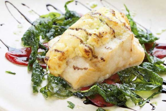 Steamed codfish with spinach and lemon