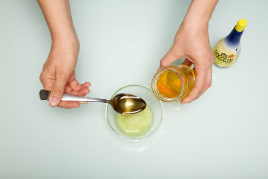 Honey added in the bow with other ingredients for the cleansing mask