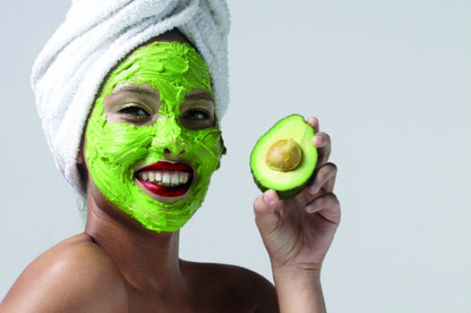A girl with a lemon and avocado skin-toning mask applied to her face